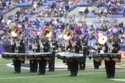 The Ravens Marching Band performs on the field prior to the start of Sunday's Packers-Ravens game.