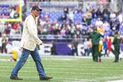 Baltimore Ravens owner Steve Bisciotti walks on the field prior to the start of Sunday's Packers-Ravens game at M&T Bank Stadium.