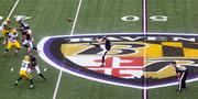 Baltimore Ravens punter Sam Koch kicks the ball to the Packers during the first quarter of Sunday's game.