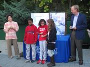 Laurie Schwartz, president of the Waterfront Partnership of Baltimore; fourth-grade students from the Green School of Baltimore; and Chesapeake Bay Foundation President William Baker.