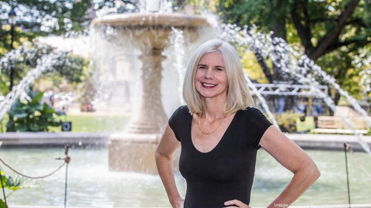 Catherine Qureshi, Pittsburgh Parks Conservancy's president and CEO at the Patricia Rooney Memorial Fountain in Allegheny Commons Park.