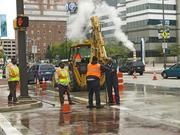 City workers move to repair a water main break along Market Place and Pratt Street on Wednesday morning.