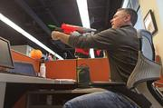 Paul Clement, director of legal services at Videology, fires disks from his Pyragon Nerf gun.