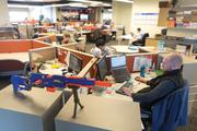 At least 60 Nerf guns are strewn throughout the video advertising company's Locust Point office.