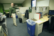 Jeld-Wen Field's communications center (being surveyed by Timbers environmental services chief Brian Kennedy) is designed with sustainability in mind. The cubicles consist of repurposed goods and teem with Office Depot-supplied receptacles and other goods from environmentally certified sources. Game day operations are overseen from the center, which sits near Jeld-Wen's pitch.