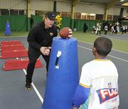 Jags player Sam Young helps out during a football/cheerleader coaching clinic.