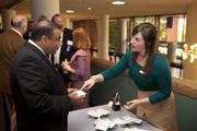 Purna Veer, owner and CEO of V-Soft Consulting, left, was greeted at the Fast 50 reception.