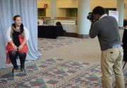 Brittany Wallman gets a free headshot from volunteer photographer Dave Bassey.