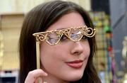 Michaela Prachthauser of Orlando models steam punk-style glass frames made by her dad, Francis. The Prachthauser's company, Handmade Bronze, was one of the many vendors selling costume accessories during the convention.