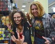 "Zombie girls Claudia Vazquez and Alicia Wegorzewski of Orlando put the ""pose"" in decomposed."