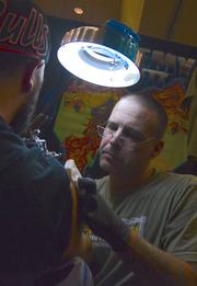 Dunedin artist Jeremy Hulett at work in Tattoo Alley.
