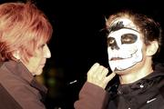 Makeup artist Margi McGuire works on the face of Ronni Bolconi.