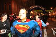 Superman leads a group of runners at the start of the 5K Costume Zoom.