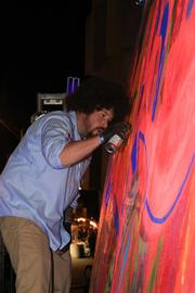 Real-time street murals were done by the Midnight HighBall Artists.