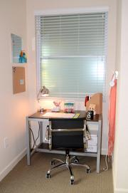The second bedroom has an alcove that can be used as office space.