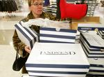 Lands' End hires former RadioShack CEO; will take write-down of $90M-$110M