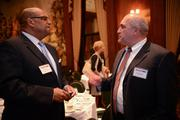 Floyd Cephas, left, of North Side Christian Health Center talks with Randy Heranic of Dollar Bank.