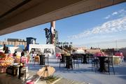 Legendary Rooftop event spaces are located above Charming Charlie's at Legends Outlets Kansas City. A spokeswoman says a large wall between the areas will prevent parties from interfering with one another.
