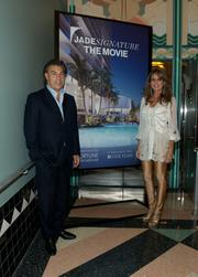 Edgardo and Ana Cristina Defortuna of Fortune International with their poster for the Jade Signature movie night