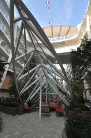 This sail like structure has windows that allow light into the promenade underneath.