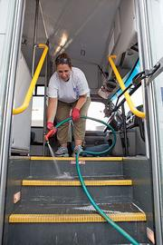 United Way Day of Caring volunteer Karen Jacobson from helps clean a bus at Community Services for the Developmentally Disabled, a $28.8 million nonprofit service provider.