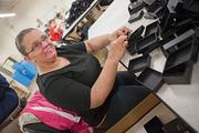 Amandalyn Birt has worked for five years assembling jewelry boxes in the work center operated by the Resource Center in Jamestown, the second-largest nonprofit in the region.