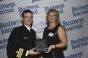 2013 Health Care Hero recipient Commander James Keck, M.D. of Naval Hospital Jacksonville and Dr. Dawn Emerick of the Health Planning Council.
