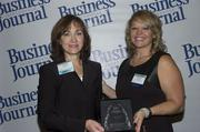 2013 Health Care Hero recipient Cindy Danner of Mayo Clinic and Dr. Dawn Emerick of the Health Planning Council.