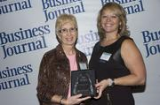 2013 Health Care Hero recipient Shelly M. Brock ARNP of Mayo Clinic and Dr. Dawn Emerick of the Health Planning Council.