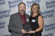 2013 Health Care Hero recipient Dr. Keith Stein of Baptist Health and Dr. Dawn Emerick of the Health Planning Council.