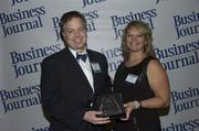 2013 Health Care Hero recipient Dr. Jay Van Gerpen of Mayo Clinic and Dr. Dawn Emerick of the Health Planning Council.
