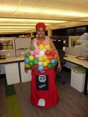 An employee at Blue Cross Blue Shield of Kansas shows off a gumball machine costume.