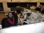 A vampire works at his desk at Blue Cross Blue Shield of Kansas City.