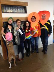 Staff members at Travois showcase their Halloween costumes. The mission-driven consulting firm is located in the Crossroads Arts District and is focused on promoting housing and economic development for American Indian, Alaska Native and Native Hawaiian communities.