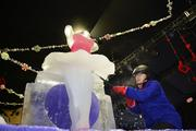 Chinese ice sculpter Zhi Gang Gao works on a ballerina that tops six ice-slides from The Nutcracker-themed ICE! event at the Gaylord Texan.