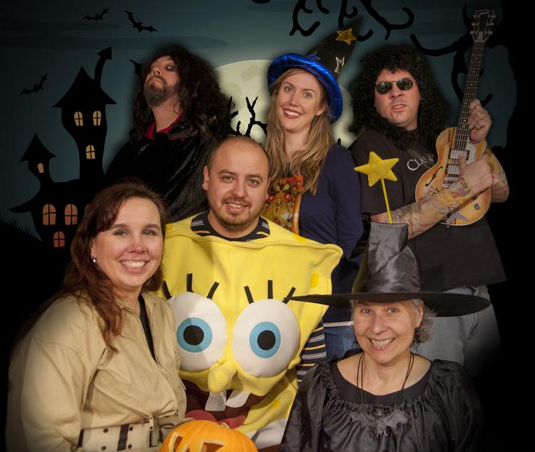 employees in kansas citys communications office break out their eclectic costumes for a group photo