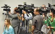 The media at the press conference.