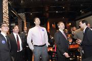 Peacock supporters check election results at Dilworth Neighborhood Grille.