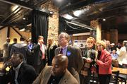 """Supporters of Edwin Peacock for mayor await election results at Dilworth Neighborhood Grille. Peacock said his campaign had a """"holy cow"""" moment as Cannon's lead dwindled during the evening, according to WBT."""