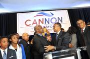 Cannon shakes hands with Gantt, who was elected mayor 30 years ago this week.