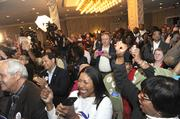 Cannon supporters cheer election results Tuesday night at the Sheraton.