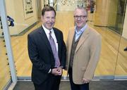 Doug Chesnut of Street Lights Residential and One Dallas Center developer Shawn Todd inside the new lobby.