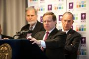 Koonin's big-data work at NYU gets the attention of powerful people in business and government. Here, NYC Mayor Michael Bloomberg stands behind Koonin at a CUSP open house.