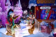 Chip and Dale build a snow chipmunk and have a snowball fight on their float.
