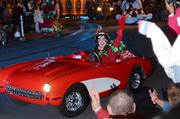Little kids and a tiny red car. Children of the '80s see a Prince reference (hint: it's a little red Corvette).