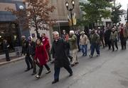 Louisville Mayor Greg Fischer walks in the Veteran's Day Parade alongside Louisville-Jefferson County Metro Government employee veterans.
