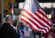 The sunlight illuminates an American flag Monday during the parade.
