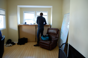 Alex Howell, CEO of Incomparable Things, stands in his living room/company headquarters in Northeast Portland. The company began working out of the three-bedroom house, that the three-member team also calls home, in June. While the weather was nice, the office was on the porch.