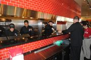 The Shula Burger kitchen was busy flaming up some burger patties and serving up hungry fans.