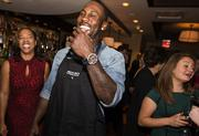 Boldin laughs at a joke during the reception, which was followed by a four-course meal served by past and present 49ers players.